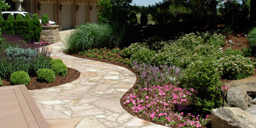 Natural stone walking path with floral accents