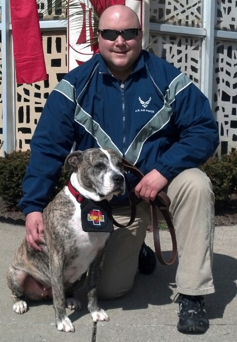Photo of gray and white dog named Alex with her owner, Chip Ingersoll