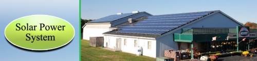 Photo of our solar power system on and around our building.