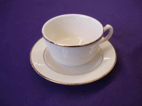 Coffee cup and saucer with gold trim