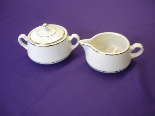 Cream and sugar sets with gold trim